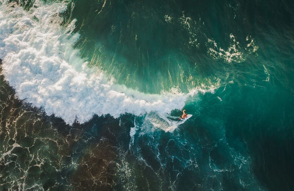 Surfer Captured by Drone © Dmitry Pustovalov / Shutterstock.com