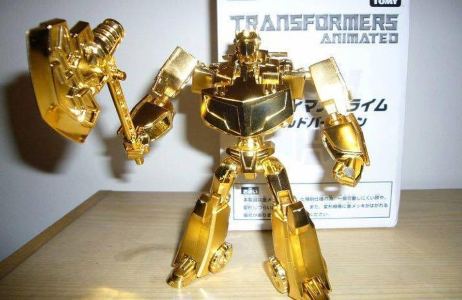 Transformers - Gold Optimus Prime@Planetiacon.stfu / Facebook.com