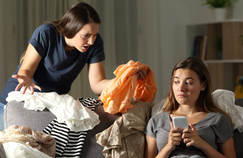 Angry Girl Scolding Roommate © Antonio Guillem   Shutterstock.com