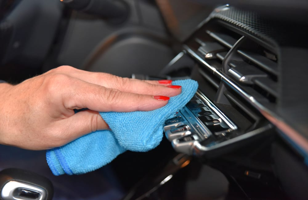 Cleaning Center Console @algre / Shutterstock.com